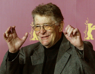 Italian director Ermanno Olmi poses during a photocall for the film 'Tickets' at the 55th Berlinale ..