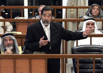 Former Iraqi President Saddam Hussein speaks during his trial in Baghdad