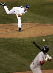 Trenton Thunder pitcher Roger Clemens delivers a pitch to the Portland Sea Dogs John Otness during third inning Eastern minor league baseball action in Trenton