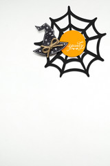 Happy halloween / Creative halloween concept photo of witches hat made of paper on white background.