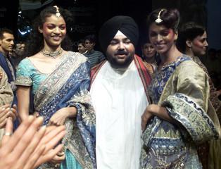 INDIAN FASHION DESIGNER J. J. VALAYA WALKS WITH MODELS AT THE END OF PRESENTATION OF HIS ...