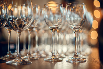 Close up picture of empty glasses on the wooden counter  in restaurant