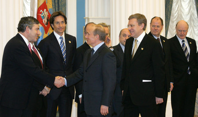 Russian President Putin welcomes G8 finance ministers and international financial officials in Moscow's Kremlin