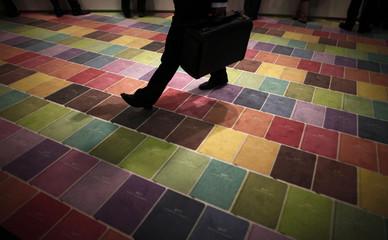 A man walks over a colourful carpet at an exhibition stand at the Frankfurt book fair