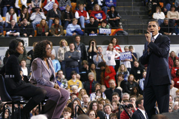 U.S. Democratic presidential candidate Senator Barack Obama (D-IL) speaks as entertainer and talk show host Oprah Winfrey and his wife Michelle listen at a rally in Cedar Rapids, Iowa