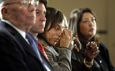 WIFE OF SNIPER VICTIM WIPES TEARS AT WASHINGTON PRESS CONFERENCE.