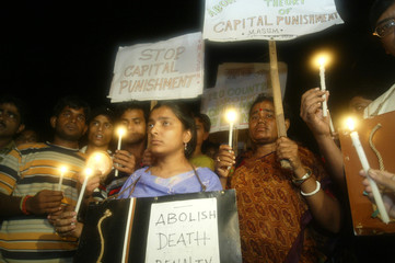 Activists hold candles during rally protesting capital punishment in Calcutta.