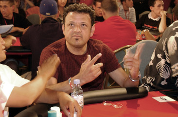 Rodriguez reacts to being eliminated in celebrity poker tournament in Honolulu.