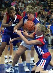SLOVAKIA'S KOVACOVA FIGHTS FOR BALL WITH FRANCE AT SYDNEY OLYMPICS.