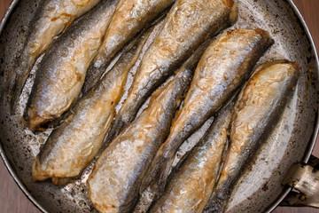 Fried fish herring, Fried fish in a frying pan