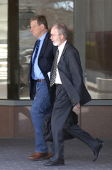 Film director McTiernan leaves with attorney Carlton following arraignment in Pellicano case at Federal Building in Los Angeles