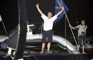 French skipper Lemonchois celebrates his victory at Pointe-a-Pitre harbour in the French Caribbean island of Guadeloupe