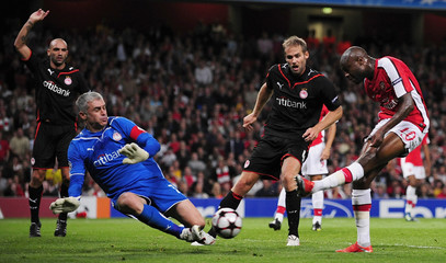 William Gallas of Arsenal has his shot blocked by Antonis Nikopolidis of Olympiakos during their Champions League soccer match at the Emirates Stadium in London