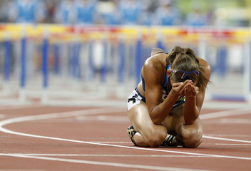 Jones of the U.S. reacts after coming in seventh in the women's 100m hurdles final of the athletics competition at the Beijing 2008 Olympic Games