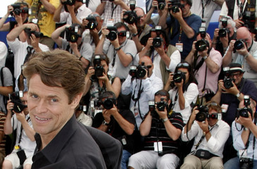 "Cast member Dafoe poses during a photocall for the film ""Antichrist"" at the 62nd Cannes Film Festival"