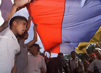 SUPPORTERS OF PRESIDENT CHAVEZ PROTEST AGAINST HIS ARREST IN CARACAS.