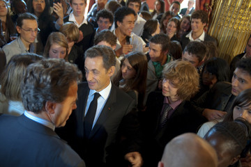 France's President Sarkozy and Education Minister Chatel discuss with students at the Elysee Palace