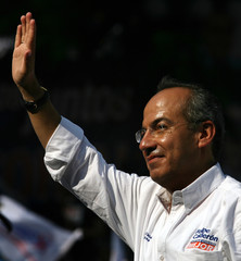Calderon Mexican presidential candidate for the National Action party waves during a campaign rally in Cuernavaca