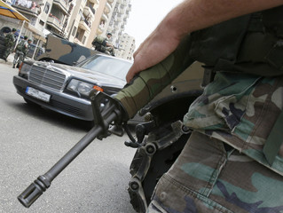 A car passes a Lebanese army checkpoint in Tripoli city in northern Lebanon