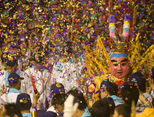 Worshippers take part in a procession during the annual pilgrimage in honour of the sea goddess Matsu in Dajia city in Taiwan
