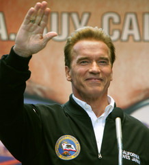 California Governor Schwarzenegger waves to visitors at a California Festival held in Tokyo.