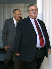Secretary of Defense Donald Rumsfeld and Iraq's President Jalal Talabani speak at a news conference.