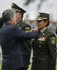 Colombian Police General Luz Marina Bustos is promoted to General by Colombia's President Uribe during a promotion ceremony at a police school in Bogota