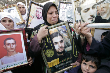 Families of Palestinian prisoners held in Israeli jails attend an anti-Israel protest in Gaza