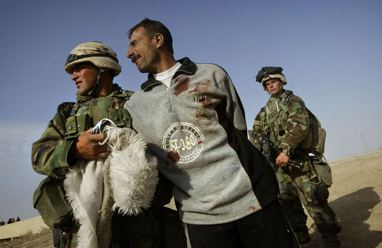 WOUNDED IRAQI MAN BEGS TO BE RELEASED IN CENTRAL IRAQ.