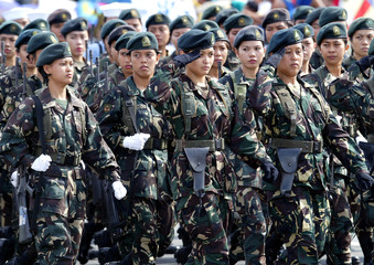 Members of the Philippine military march during Independence Day in Manila.