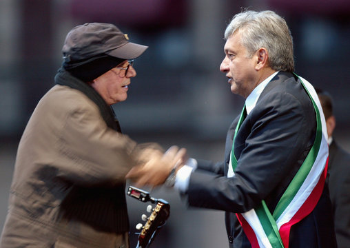 """Andres Manuel Lopez Obrador  is congratulated by Cuban singer Silvio Rodriguez after he was sworn in as """"legitimate president""""  at Mexico City's Zocalo square"""