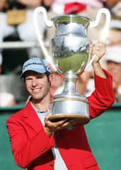 Britain's Dredge holds up the trophy after winning the European Masters golf tournament in Crans-Montana