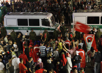 Police separate Turkish and German soccer fans after the Euro 2008 semi-final match between Germany and Turkey in Berlin