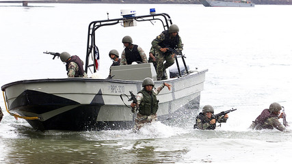 Panamanian soldiers train to protect the Panama Canal during mauneuvers with U.S. and Latin American ...