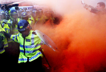 Pro-hunting demonstrators clash with police outside the Houses of Parliament in London.