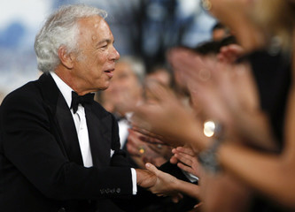Designer Ralph Lauren greets an audience member after his Spring 2008 collection show during New York Fashion Week