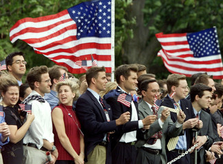 WHITE HOUSE STAFF HOLD FLAGS AS PRESIDENT BUSH TAKES OFF ON MARINE ONE.