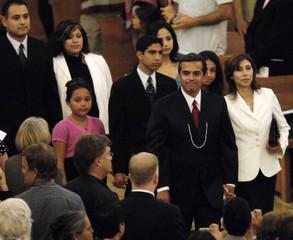 Los Angeles Mayor-elect Villaraigosa and his wife Corina arrive for a pre-inauguration interfaith ...