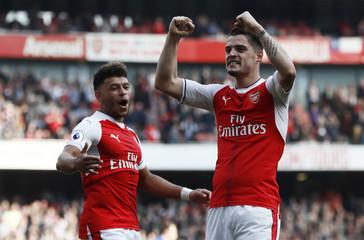 Arsenal's Granit Xhaka celebrates scoring their first goal with Alex Oxlade-Chamberlain