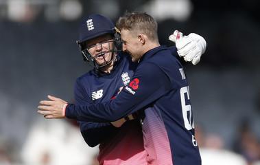 England's Joe Root and Sam Billings celebrate taking the wicket of Ireland's Gary Wilson