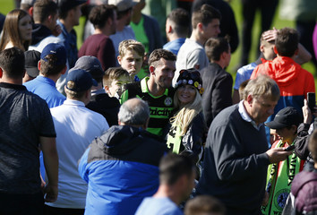 Forest Green Rovers' Christian Doidge celebrates on the pitch at the end with fans