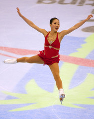 MICHELLE KWAN LEAPS ON HER WAY TO WINNING US CHAMPIONSHIPS.