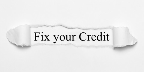 Fix your Credit on white torn paper