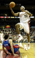 Cavaliers James scores two in front of Pistons Delfino in Cleveland