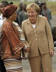German Chancellor Angela Merkel meets with Liberias President Ellen Johnson Sirleaf in the capital Monrovi
