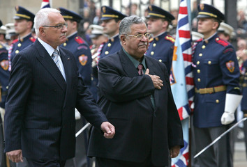 Czech President Vaclav Klaus accompanies the President of Iraq Jalal Alabani past a guard of honour upon his arrival at Prague Castle