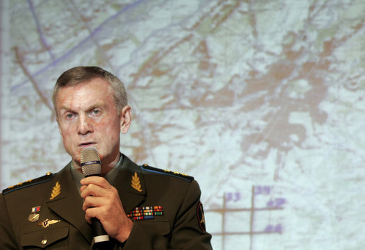 Russian General Staff's Colonel General Nagovitsyn stands in front of map showing parts of Georgia's breakaway region of Abkhazia during news briefing in Moscow