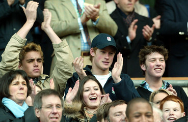 Britain's Prince Harry (C) applauds during England's Six Nations rugby union match against [Italy] a..