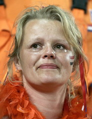 A Netherlands supporter reacts on her team's 2-1 loss against Portugal after a Euro 2004 semi-final ..