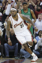 Cleveland Cavaliers' James reacts after a dunk against Boston Celtics during their NBA Eastern Conference semi-final basketball series in Cleveland